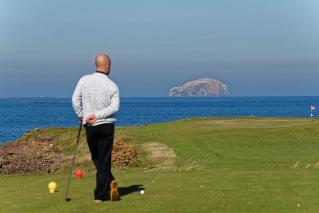 golfer enjoying costal view