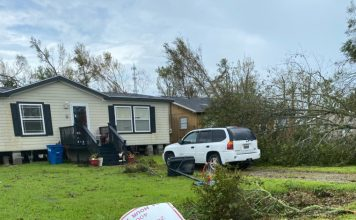 manufactured home endures hurricane laura downed tree