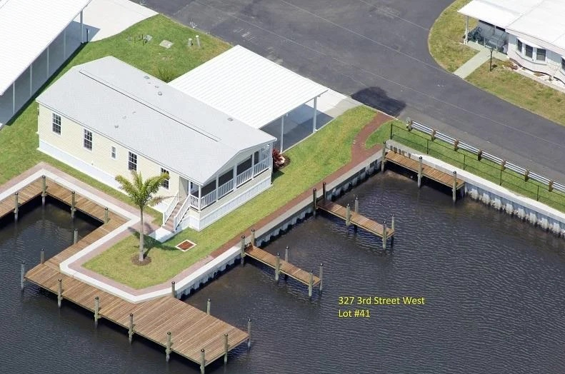 Aerial view of waterfront manufactured home for sale in Palmetto, FL