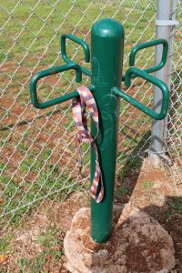 A dog park leash tree in Eagle Creek manufactured home community